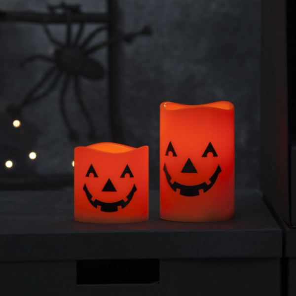 "LED Kerzen ""Halloween"" - 2 gelbe LED - D: 7,5cm H: 11,5cm und 7,5cm - Batterie - orange - 2er Set"